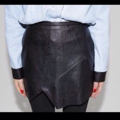 Asymmetrical Faux Leather Skirt Brand new in packaging, never worn. Purchased and then never wore it due to a change in personal style. Was a host pick from other shop! Has been in packaging for awhile, may need to be cleaned to iron out the folding creases. ASOS Skirts