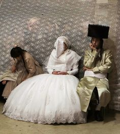 DOUBLE STANDARD? You are looking at Jewish bride Rivka Hannah sitting next to her groom Aharon Krois during the Mitzvah Tans dance ritual following their wedding in an ultra-orthodox neighborhood of Jerusalem. If a Muslim woman in hijab sat in her place, there would be claims that Muslim women are oppressed, backward and have no freedom. But there are no negative comments as long as this is in Israel or any non-Muslim society. (AFP)