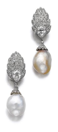 Suzanne Belperron - A pair of natural pearl and diamond ear clips, circa 1935. Each surmount designed as a feather set with circular-cut diamonds and a pear-shaped diamond, supporting a detachable pendant set with a baroque drop shaped natural pearl, capped with rose diamonds, French assay marks, maker's marks for Groene et Darde. #Belperron #vintage