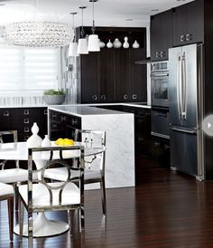 Dark cabinetry and white accessories create contrast and drama in this kitchen. {Photography by Virginia Macdonald}