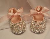 Oh my gosh baby shoes full of rhinestones love it.