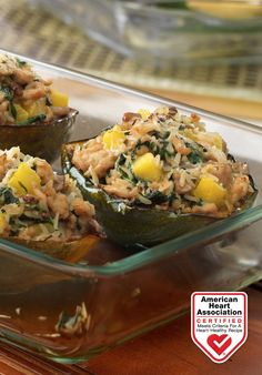 Signature Stuffed Squash — Baked squash halves are hollowed out and filled with scrumptious ingredients for a flavorful dish! Heart-Check Certification does not apply to recipes or information reached through links unless expressly stated.