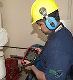 A pin showing an engineer taking measurement readings using condition monitoring equipment...