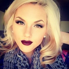 The dark lips look perfect with this style, and her clothes.