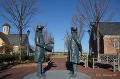 This sculpture shows General George Washington, commander of the American forces and Admiral Francois De Grasse, commander of the French Fleet, at the site of the victory over Cornwallis in Yorktown which signalled the end of the American Revolution. It is located at the Riverwalk Landing in Yorktown, Virginia.  Yorktown Surrender