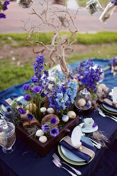 tablescape with driftwood and delphiniums