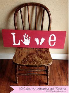 "Child's handprint & footprint ""love"" sign."