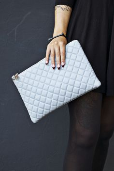 I love the color of this clutch - it adds a little something to each of my outfits.