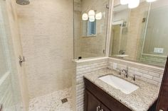 Contemporary 3/4 Bathroom with Complex granite counters, specialty door, Undermount sink, Flush, High ceiling