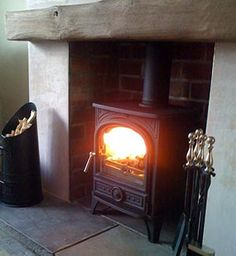 Wood burning stove~ into the fire place Wood Burner Fireplace, Fireplace Hearth, Fireplaces, Oak Mantle, Fireplace Ideas, Wooden Fireplace, Cottage Fireplace, Mantel Ideas, Bedroom Fireplace