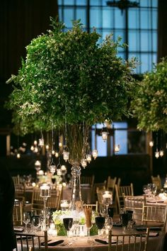 Tress are a popular centerpiece but you don't need actual ones - here lush green branches simulated small trees ~ https://www.insideweddings.com/weddings/classic-greek-orthodox-ceremony-modern-reception-in-new-york-city/702/