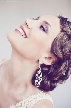 Brown hair with heavy golden highlights and beautiful updo to show them off. Great wedding do and makeup is fresh!