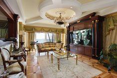 Luxury Family Room With Large Aquarium and Elegant Furnishings.