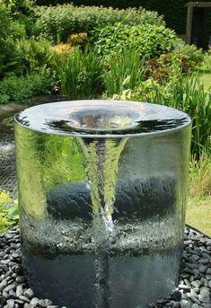 The stunning Volute water feature by Tills Innovations. A vortex being captured and displayed in clarity and detail. What appears to be a solid piece of glass with a spinning vortex. A mesmerising water feature.                                                                                                                                                                                 More  #GardenDesign