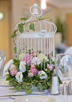 Idea for table centres with flowers to match colour theme