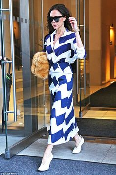 Feeling blue: On Monday Victoria Beckham reminded onlookers just why she was a sartorial l...