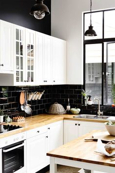 Black and White Kitchen Picture. Black and White Kitchen Picture. Black and White Kitchen Ideas White Kitchen Island, White Kitchen Cabinets, Black Backsplash, Black Kitchens, Kitchen Black, Kitchen Pictures, Beautiful Kitchens, Kitchen Decor, Kitchen Ideas