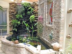 Waterfall & landscape plants have been included in an indoor fern wall ...