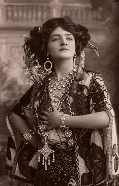 "Lily Elsie in ""The Merry Widow"". Actress and singer. What an elaborate costume."