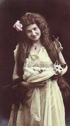Woman holding her cat