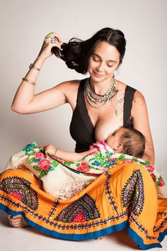So much to love about this picture. But what I'm loving the most (other than the adorable baby) is her fabulous boho style.