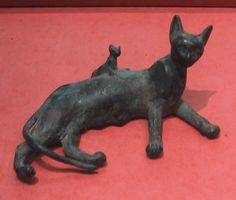 Two of my favorite things, cats and Egypt.  Ancient Egyptian bronze statue of a reclining cat and kitten.