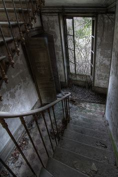 I can almost hear kids running up and down these stairs. How sad and forlorn they are now