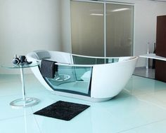 Smart Hydro smart bathtub keeps your bathwater from getting cold, cleans itself! This room is a little too modern for my taste but that tub is soo amazing. Home Interior, Interior Design, Bathroom Interior, Cool Technology, Technology Gadgets, My New Room, Smart Home, Cool Gadgets, Tech Gadgets