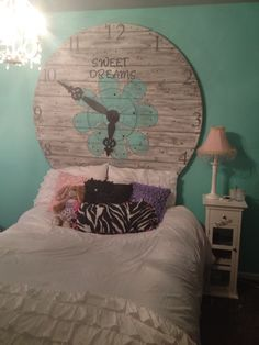 Wood spool top made into a clock and headboard for my daughters room.  Super fun and easy to make!