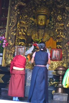 A Buddhist Nun And a Women Praying