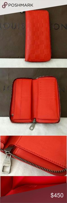Authentic Louis Vuitton Zippy Red Infini Wallet Authentic Hard to find Louis Vuitton Large Vertical Zippy Wallet Infini Red Fusion Leather. The wallet is in good pre loved condition with some wear on edges as seen on the pictures. Clean in and out side, no odors. This beautiful bright wallet comes with LV paper bag only Louis Vuitton Bags Wallets
