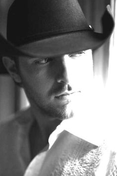That look, the hat, the boots, that deep sexy voice and dance moves...yes he has it all :)  >>Chris Young