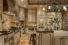 Luxury Kitchen Corner stone fireplace in kitchen!Southwestern Ranch - Luxury Calvis Wyant Homes Tuscan Kitchen Design, Kitchen Interior, New Kitchen, Kitchen Island, Kitchen Designs, Kitchen Layout, Kitchen Cabinets, Kitchen Rustic, Kitchen Modern