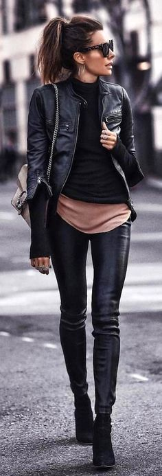#spring #outfits woman wearing black leather zip-up jacket facing left standing on gray concrete pavement. Pic by @fashionista_east