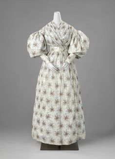 Summer Dress of Printed Fabric, c. 1830 - c. 1832. Typical of fashion in the 1830s is the so-called leg-ofmutton or gigot sleeve, puffing just below the shoulder and fitting closely around the forearms. This dress was probably worn, and also possibly made by the seamstress Anna Maria van den Bijllardt. It is crafted with utmost skill, and subtly decorated with fine pleats and piping made of the same fabric at the seams.