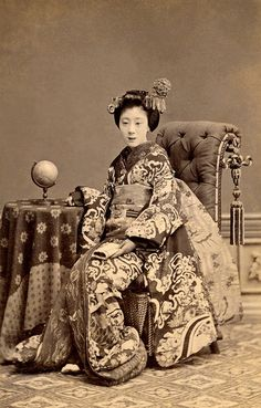 beautifulcentury:  A Maiko with a Terrestrial Globe 1880s by Blue Ruin1 on Flickr.  Via Flickr: A Maiko (Apprentice Geisha) in full ceremonial dress, seated beside a terrestrial globe.  This small carte-de-visite photograph is by my favourite photographer, Narui Raisuke.