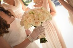 Sheer white gloves and a puffy all white rose bridal bouquet // found on Modern Jewish Wedding Blog // Photographer: A Magic Moment Photography and Video