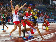 Conrad Williams, Matthew Hudson-Smith and Daniel Awde of England celebrate winning gold in the Men's 4x400 metres