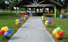 Balloons staked to the ground, maybe out front or marking a path the back gate?