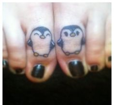 Cute little penguin tattoo! I Love penguins. One should have a bow tie and the other a bow!!!