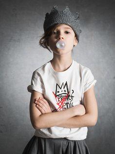 Katrina Tang Photography for Xenia Joost design AW 14 kids fashion. Studio shoot with a girl blowing a bubblegum, arms crossed #katrinatang #tangkatrina