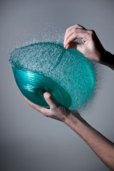 Edward Horsford's High-speed photography captures a water balloons pop at 1/40,000ths of a second.