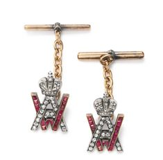 Grand Duke Andrei Vladimirovich: A pair of jeweled gold and silver cufflinks, Warsaw, 1920-1931, the links formed as the Grand Duke's Imperial cypher set with diamonds and rubies, with gold bars set with bands of rose diamonds.