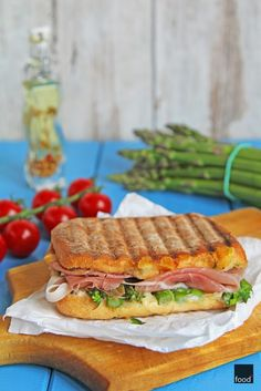 Grilled sandwich with asparagus, camembert and prosciutto.