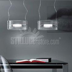 Leucos Vittoria lampada a sospensione con diffusore in vetro soffiato cristallo trasparente. Struttura e schermo anti-abbagliamento in metallo cromato.