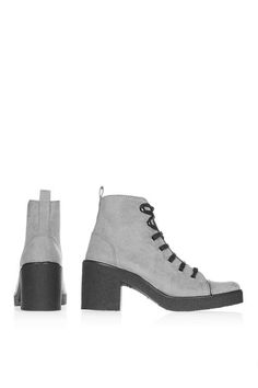 Invest in a quirky addition to your wardrobe with these grey ankle boots. Equally versatile and stylish, these shoes have a cool lace up detail and comfortable heel height perfect for day-to-day wear. #Topshop