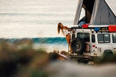 Land Rover Defender 110 Camper close to sea.I love woman in Defender Life… Landrover Defender, Land Rover Defender Camping, Defender Td5, Dodge Ram Van, Adventure Is Out There, Adventure Time, Adventure Travel, Travel Trip, Into The Wild