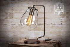 Featured is an eye catching Glass Shade Edison Bulb Table Lamp - Bronze showcasing a beautiful 'pear style' glass shade suspended above a walnut base.