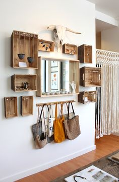 Old crates can be used as shelving to create an eclectic hallway.