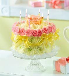 Birthday cake covered in fresh flowers